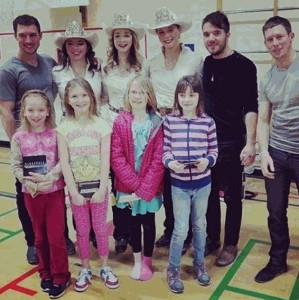 Big Rock School kicked off a full week of literacy activities with a concert by Calgary band Swift Olliver and a visit by Stampede Princesses Haley Peckham and Kimberly Stewart, and Queen Mick Plemel (left to right between band members)
