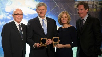 Prime Minister Stephen Harper and his wife Laureen receive the Erebus Medal from John Geiger, CEO of The Royal Canadian Geographical Society, and Dr. Paul Ruest, President of The Royal Canadian Geographical Society, for their contributions to and support for the 2014 Victoria Strait Expedition which led to the discovery of HMS Erebus during an event at the Royal Ontario Museum.