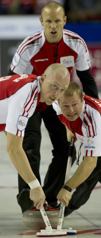 Team Canada skip Pat Simmons guides sweepers Nolan Thiessen, left, and Carter Rycroft. (Photo, Curling Canada/Michael Burns)