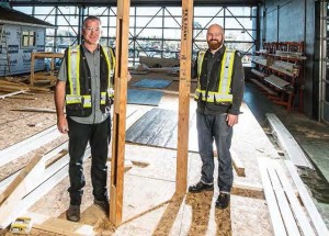 Entrepreneur Patrick Watson (left) and Joshua Brouwers (right) from SAIT Green Building Technology research initiative worked with local homebuilders to test Watson's innovative precision-manufactured rough opening frame for interior doors. (SAIT)