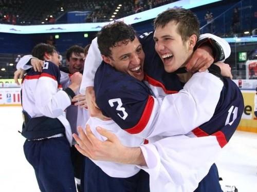 ZUG, SWITZERLAND - APRIL 26: USA's Caleb Jones #3 and Brendan Warren #11 celebrates their win over team Finland at the 2015 IIHF Ice Hockey U18 World Championship. (Photo by Francois Laplante/HHOF-IIHF Images)