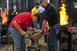 Participants in the Blacksmith Classic competition act in teams