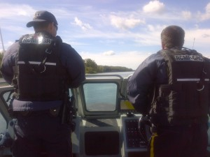 Two RCMP officers patrolling the North Saskatchewan River by boat on August 20, 2015