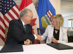 Premier Rachel Notley and Missouri Gov. Jay Nixon shake hands after signing a Memorandum of Understanding (MOU) focused on promoting economic development and trade