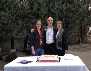 STARS' first patient VIP Kelly Waldron cutting the 30th anniversary cake with STARS founder Dr. Greg Powell and his wife Linda