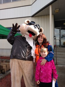 Mascot STARBear with STARS flight nurse Kellie-Ann Vogelaar and her daughter at the STARS Open House in Calgary