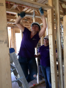 Rowan House staff help build a hounse