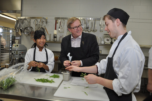 Minister Eggen with CTS students at Bishop McNally High School in Calgary