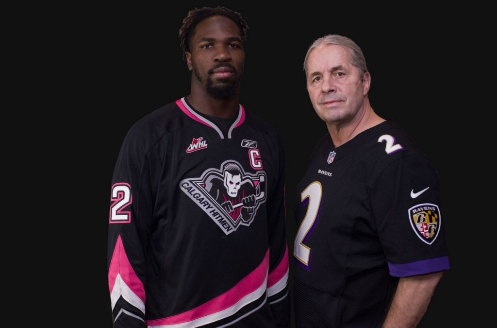 """The official jersey swap with Baltimore Ravens C.J. Mosley and WWE Hall of Famer and Calgary Hitmen owner Bret """"Hitman"""" Hart"""
