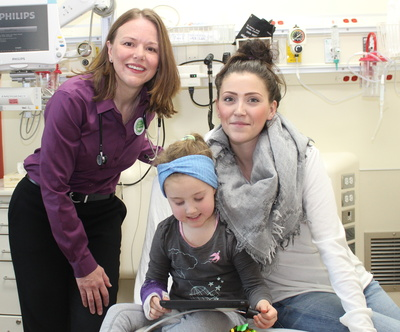 Dr. Jennifer Thull-Freedman is the quality safety lead in the emergency department of the Alberta Children's Hospital. She is pictured here with mom Lindsay McKay and her daughter Micah; McKay says the program made the emergency department experience less intimidating for her daughter.