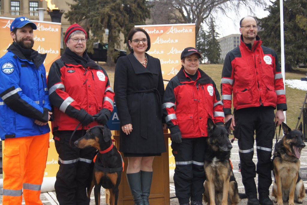 L-R:: Bart Pouteau, Michelle Limoges and dog Tynder, Minister of Municipal Affairs Danielle Larivee, Maryann Warren and dog Gotta, and Mike Arychuck and dog Jaida. The Government of Alberta will provide $300,000 to volunteer-based search and rescue organizations to support training across the province.