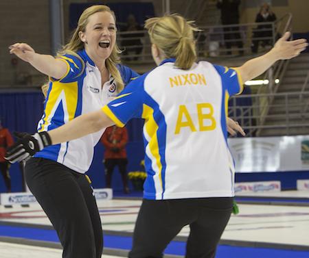 Alberta's Chelsea Carey, left, and Amy Nixon celebrate their win. (Photo, Curling Canada/Andrew Klaver)