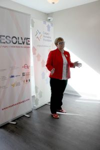 """""""I know I'm in a home because I'm standing here in stocking feet,"""" says Diana Krecsy, President & CEO of Calgary Homeless Foundation"""