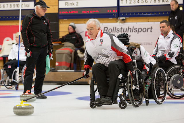 Jim Armstrong delivers his rock during the final round robin game against Germany at the World Wheelchair Curling Championship in Lucerne, Switzerland. (WCF/Céline Stucki photo)