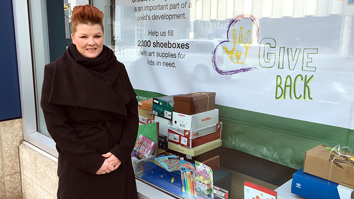 Sherry Heather, Site Manager, Sheldon M. Chumir Health Centre, stands outside of the display windows that the shoe boxes are being collecting in