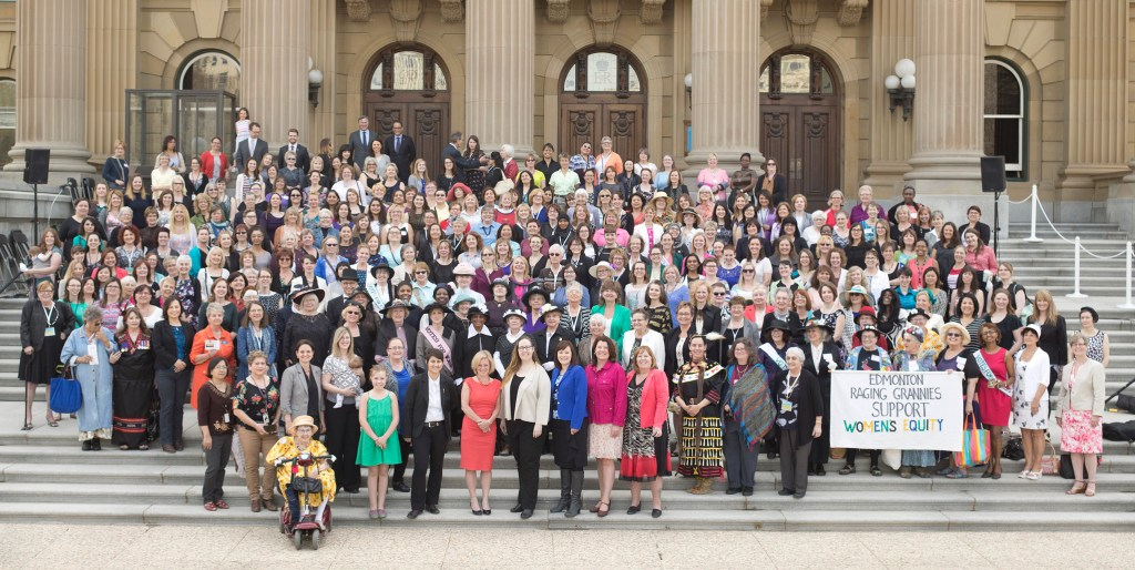 Women and men gathered on the steps of the Legislature for an updated photo of one taken in 1916 to mark passage of women's right to vote.