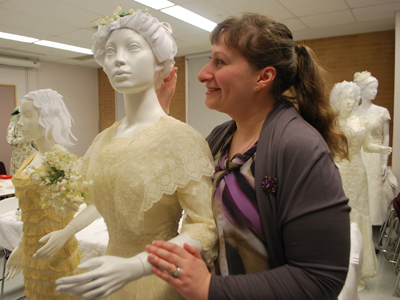 Julia Petrov puts final touches on a 1912 wedding gown, one of several that is featured in For Richer or For Poorer: Til Consumption Do Us Part, an exhibit of wedding dresses during the last century. The exhibit runs in the gallery of the Human Ecology Building from April 8 to Oct. 3.