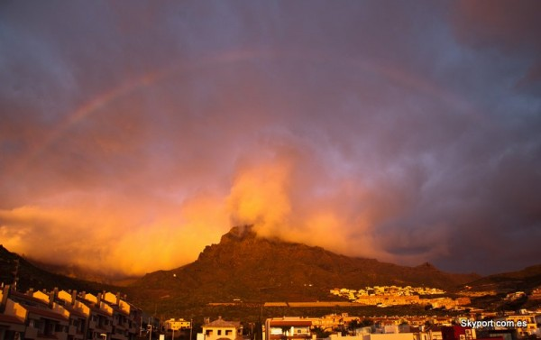 Red rainbow over Roque del Conde, on the island of Tenerife, submitted to EarthSky by Roberto Porto.