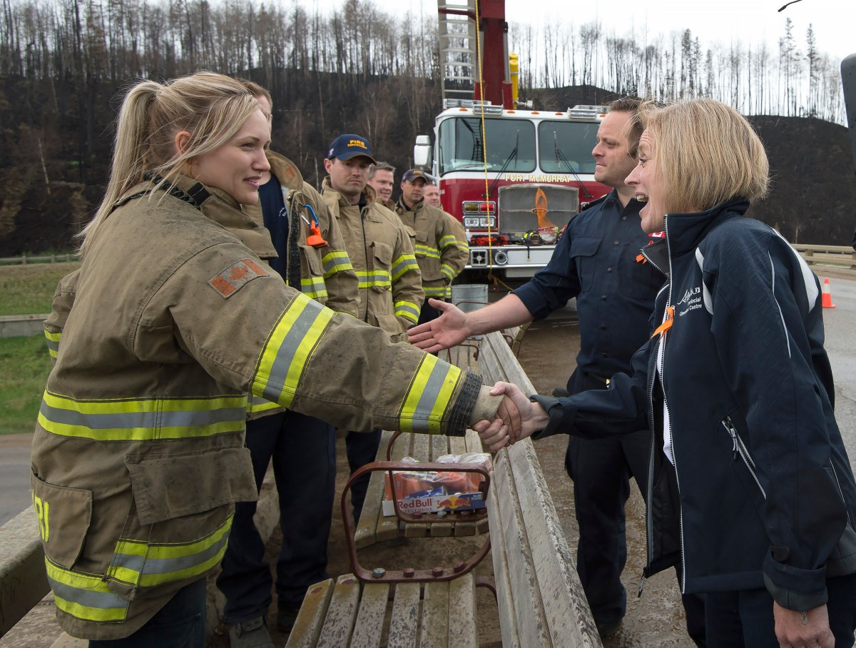 Premier Rachel Notley joined Fort McMurray firefighters to greet returning residents on the first day they are allowed back into the city, June 1, 2016. (photography by Chris Schwarz/Government of Alberta)
