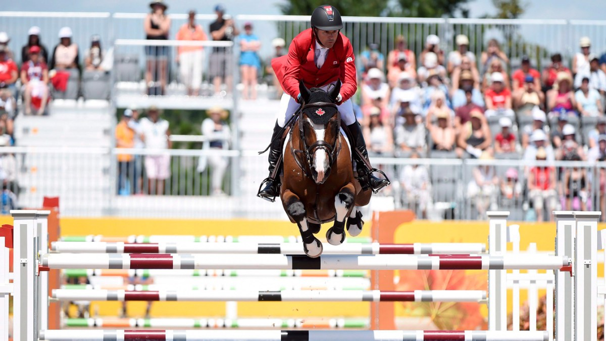 Eric Lamaze of Canada competes in the team Equestrian jumping final during the Pan American Games in Caledon, Ont. on July 23, 2015. (THE CANADIAN PRESS/Nathan Denette)