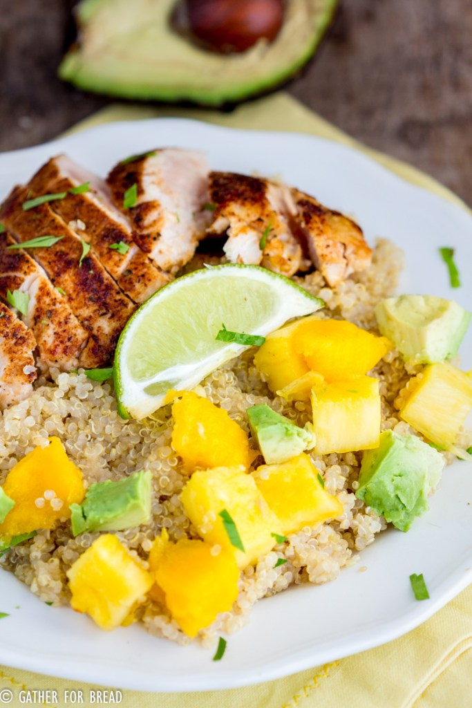 Blackened Chicken Quinoa Salad with Pineapple Mango Avocado -  Earth grains and blackened chicken are topped with fresh mango, avocado and pineapple with homemade vinaigrette. This healthy nutritious meal leaves you full and it's so good for you!