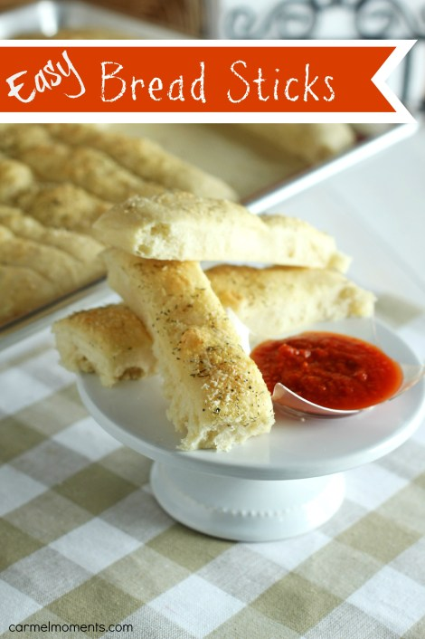 Super Easy Pull Apart Bread Sticks - Topped with herbs and cheese these soft bread sticks bake up in one pan. Just cut down and serve.