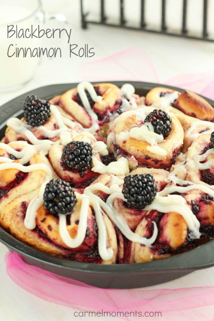 Blackberry Cinnamon Rolls - Homemade soft cinnamon rolls made with fresh blackberries. For summer brunch or breakfast. These yeast buns are a favorite. Cream Cheese drizzle topping makes them irresistible.