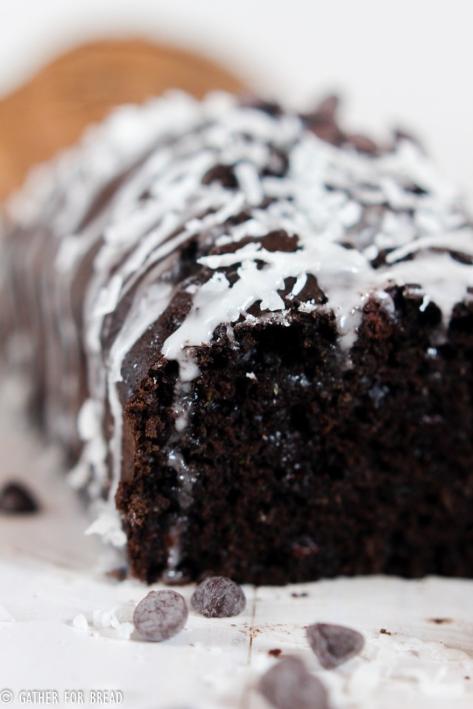 Dark Chocolate Zucchini Bread with Coconut Glaze - Recipe for moist chocolate zucchini quick bread topped with a coconut glaze. The recipe makes a sweet homeade loaf that's perfect for summer.