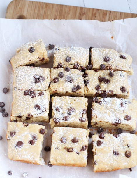 Skinny Banana Chocolate Chip Snack Bars - Amazing snack bars made lighter with Greek yogurt. Fabulous recipe whips up in just a few minutes. Perfect for ripened bananas!