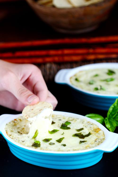Garlic herb cheese dip. With only 5 ingredients this mixes and heats up in minutes. Perfect starter or appetizer. Serve with crackers, veggies or bread. Quick and delicious!