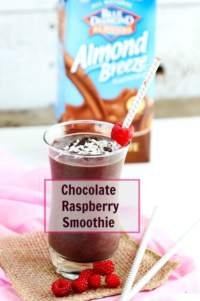 Chocolate Raspberry Smoothie - Delicious blend of frozen raspberries, cocoa, almond milk for a smooth, creamy kick start for your day. Top with fresh berries, coconut and chocolate.