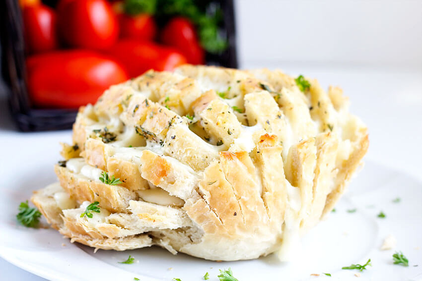 Easy Cheesy Party Bread - Garlic, buttery, pull apart mozzarella, this cheesy bread is the perfect easy appetizer for parties, game time and summer picnics.