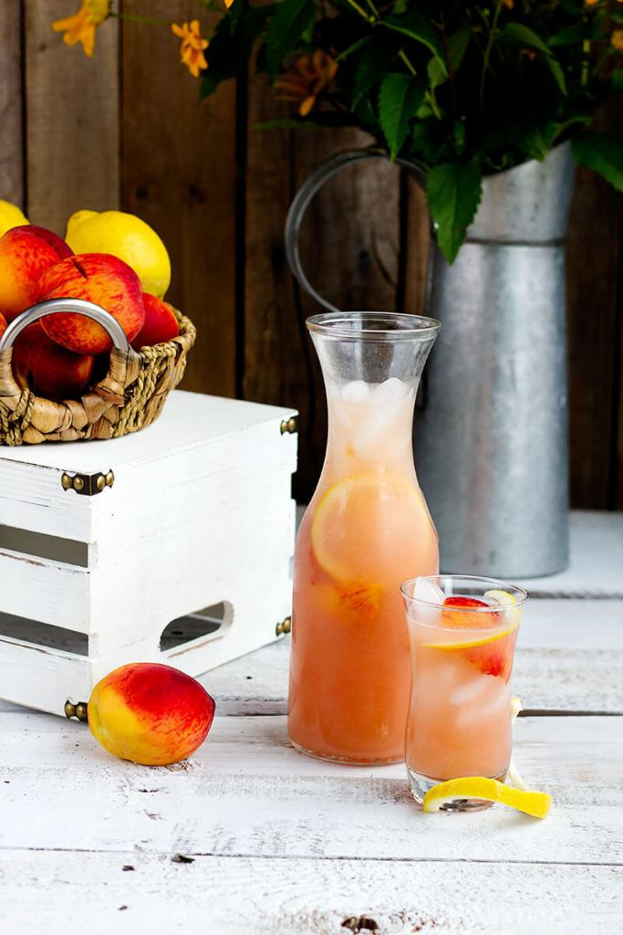 Fresh Peach Lemonade // gatherforbread.com - Refreshing summer favorite, made simple with fresh juicy peaches and lemons for a delicious thirst quencher.