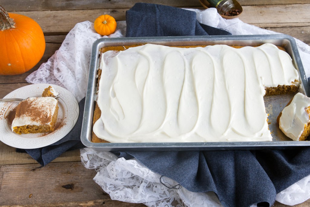 Pumpkin Cream Cheese Bars - Soft pumpkin bars, taste like cake, topped a sweet fluffy cream cheese frosting. Fall flavors that are perfect for a crowd like potlucks and bake sales.