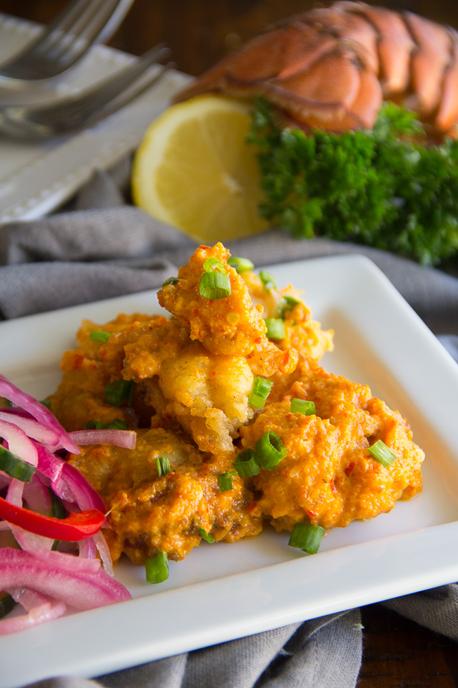 Gluten Free Spicy Lobster Bites - Lobster, lightly pan-fried succulent lobster. These gluten free bites are tossed in a spicy chili cream sauce.