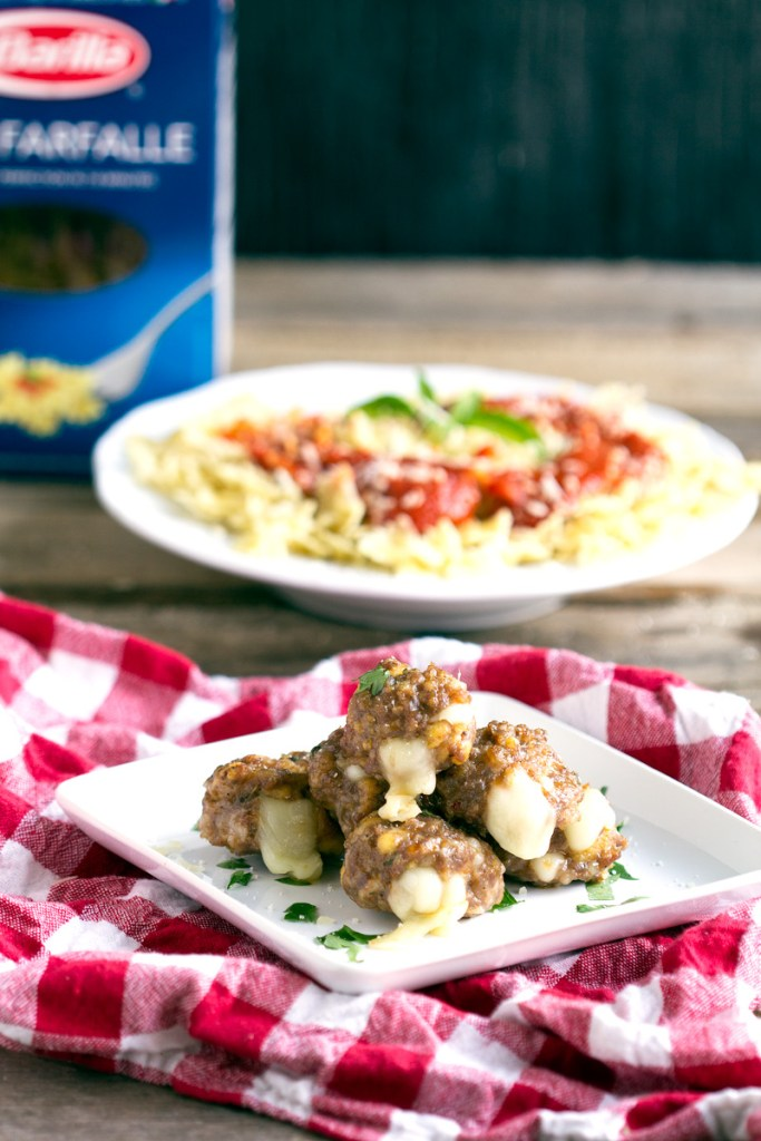 Mozzarella Stuffed Sausage Meatballs and Pasta- Homemade Italian Sausage stuffed with mozzarella cheese meatballs. Perfect for entertaining, parties, dinner and freezing for later.