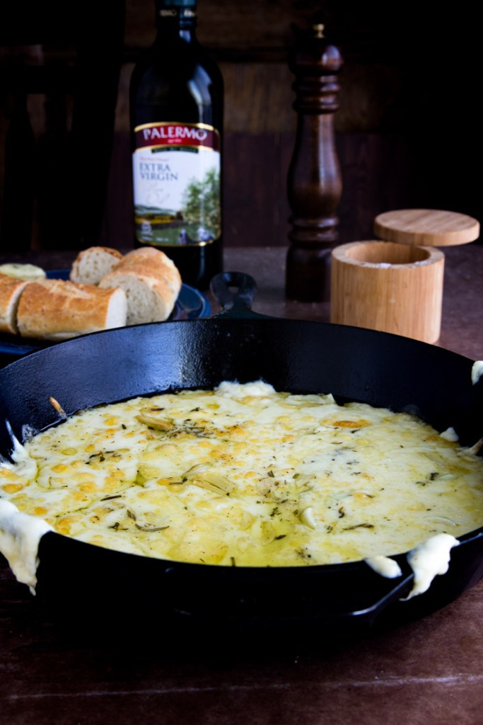 Baked Fontina Cheese Dip - Savory baked fontina, delicious blend of cheese, olive oil and herbs, paired with french baguettes for a perfect quick appetizer that's sure to be a favorite!
