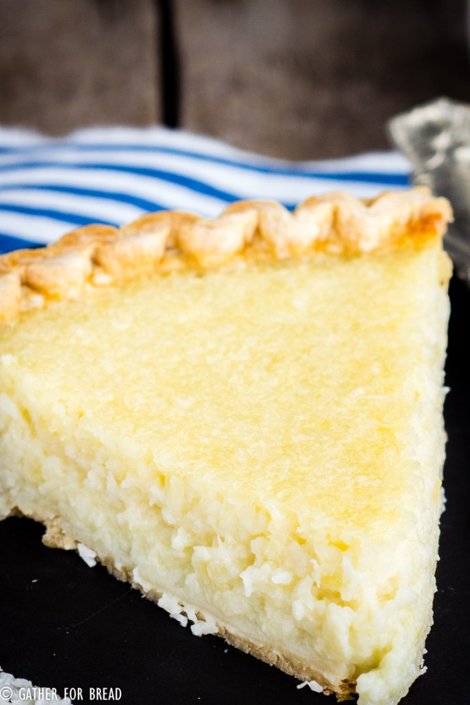 Homemade Coconut Custard Pie - Flaky coconut pie made with real custard baked in a pie crust for a perfect old fashioned taste. Easter and Thanksgiving favorite! #pie #coconut #oldfashioned