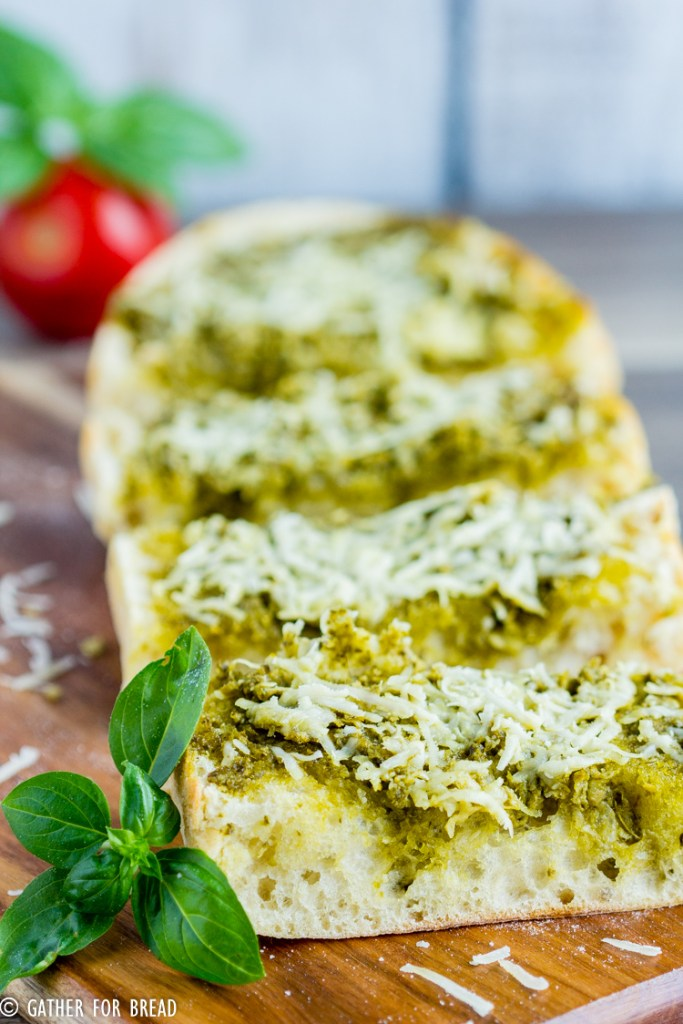 Cheesy Pesto Bread - Italian Bread made with Pesto and Parmesan cheese. Easy recipe, ready in minutes as an appetizer or side dish. Perfect for potlucks or picnics.