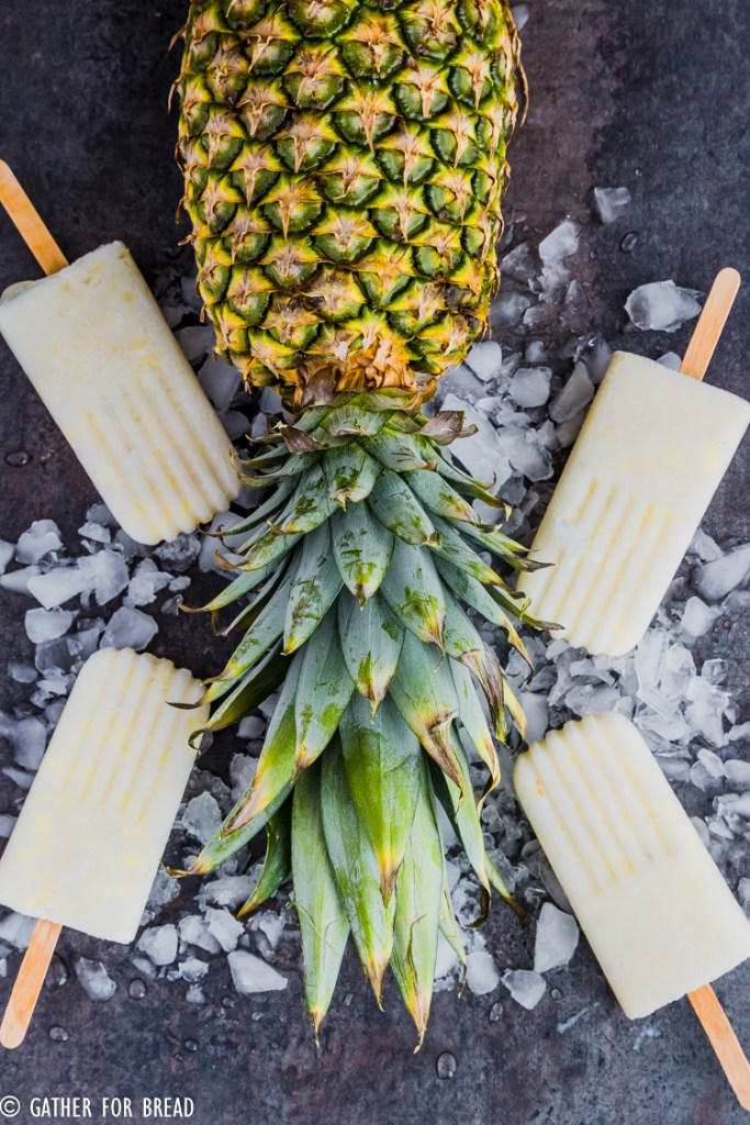 Pina Colada Popsicles - Cold refreshing pops, a perfect cold treat for summer. Make popsicles at home with REAL coconut milk, pineapple and coconut flakes for a healthy summer snack.