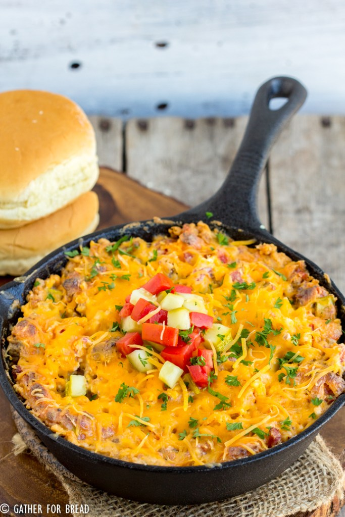 Easy Cheeseburger Dip - Ground beef mixed with cream cheese and cheddar cheese for a flavor burst of a cheeseburger in easy to make appetizer. Serve with hamburger bun dippers or your favorite cracker of tortilla chip.