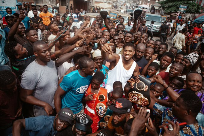 Anthony Joshua storms Makoko again, allows children display his belts