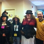 The Fox clan and friend poses at MystiCon 2013: Paula, Bethany, Meche, and Bert.