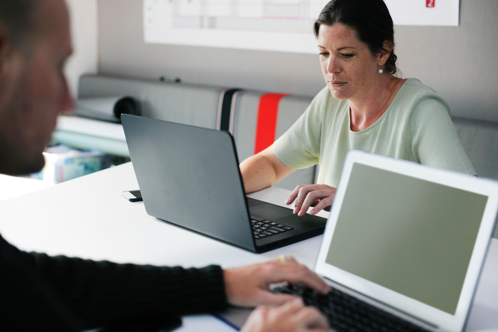 woman with laptop understanding cobit and coso
