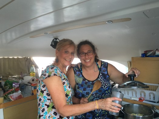 April 20 Charity and Nancy mixing up a concoction in the galley