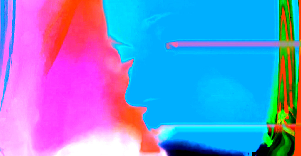 banner format image of face in profile electric blue bright pink
