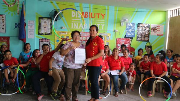 GMEFI President Even Dominguez and Mrs. Sanny Bautista, CBR-SMILE President