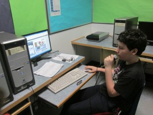 A student records his French homework directly into GoAnimate for Schools.