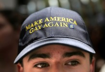 "A man wears a hat that says ""Make America Gay Again,"" a parody of Donald Trump's campaign slogan while watching the San Francisco LGBT Pride Parade in San Francisco, California, U.S. June 26, 2016. REUTERS/Elijah Nouvelage"
