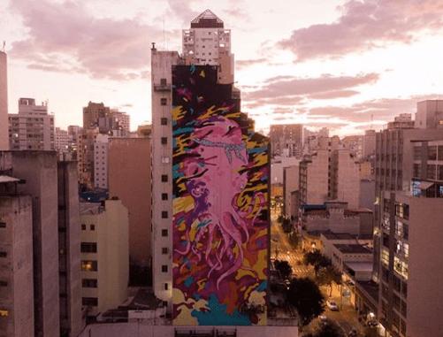 Com 15 murais em fachadas cegas, a obra 'Aquário Urbano' tem formato 360º e 10 mil metros de área pintada pelo artista Felipe Yung, o Flip